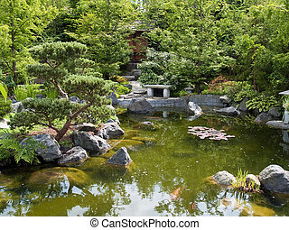 Beautiful classical garden fish pond surounded by trees