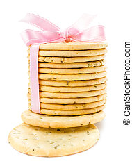 Festive wrapped with pink ribbon pastry cookies isolated on whit