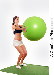 Woman gym ball workout - Pretty woman working out with gym...