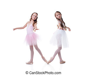 Cute sisters-ballerinas isolated on white backdrop - Cute...