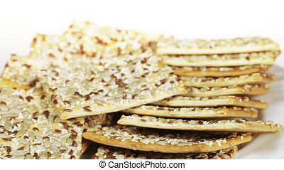 Grain biscuits - On white plate rotates Grain biscuits