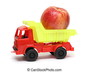 food transportation concept - toy lorry with apple