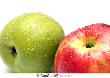 wet green and red apple fruits with water drops close-up
