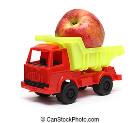 food transportation concept - toy lorry with apple isolated...