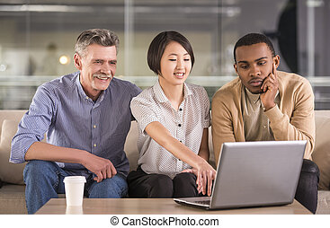 Business - Group of business people discussing the new...