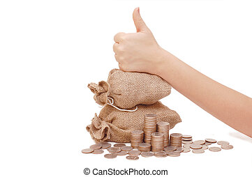 hand showing o\'key, bag with coins