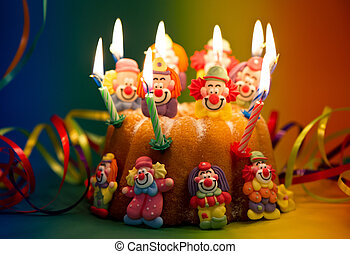 Birthday cake with sugar clown decoration and candles
