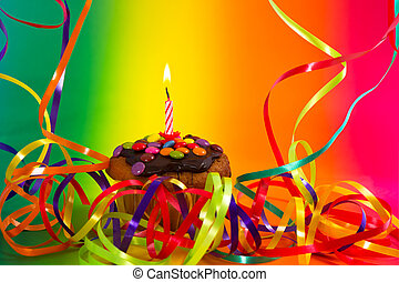 Birthday cupcake with colorful decoration and candle