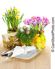 easter table setting with spring flowers and eggs