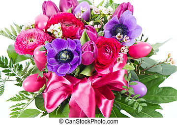 colorful easter flowers bouquet with deco eggs