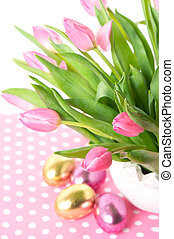 fresh pink tulips with easter eggs