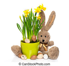 easter decoration with eggs, narcissus flowers and bunny on...