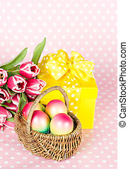 Pink tulips, easter eggs and gift box