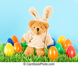 cute bear as easter bunny with colorful eggs. Decoration