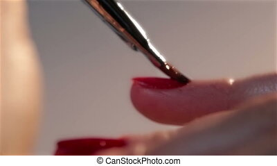 Woman doing manicure cosmetic macro close up - Woman doing a...