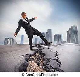 Overcome a crisis break - Businessman trying to overcome a...