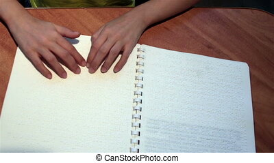 Blind hand with disability touch and read text braille...