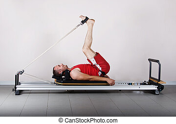 Gymnastics pilates - The L position with cords. Pilates...
