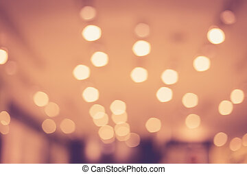 blurred image of shopping mall with bokeh, vintage color