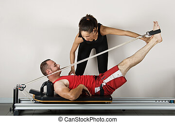 Gymnastics pilates - The reformer position with cords,...