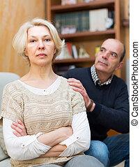 Couple after quarrel indoors