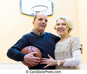 Elderly people playing with ball - Smiling mature couple...