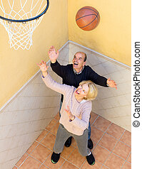 Elderly people playing with ball - Senior couple playing...