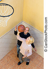 Mature spouses throwing the ball - Happy activity mature...