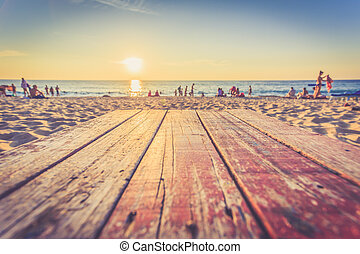 Top of wooden table at sunset beach in Thailand, Vintage...