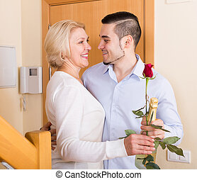man and woman standing at doorway - handsome man and smiling...