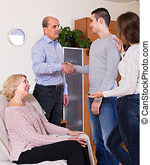 Girl introducing boyfriend to parents - Adult daughter...