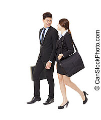 happy businessman and businesswoman walking together...