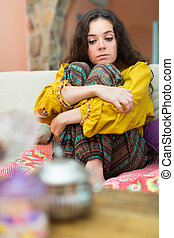lonely woman sitting on couch - Sad and lonely lady sitting...