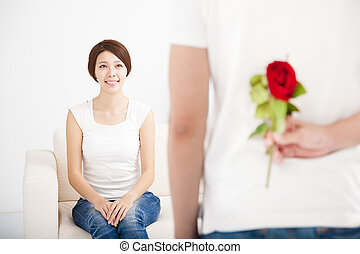 young Man offering a rose to his girlfriend
