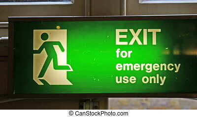 A green Exit sign for emergency use only. This is installed...