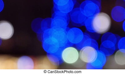 Bokeh lights from the background at night Blue and white...