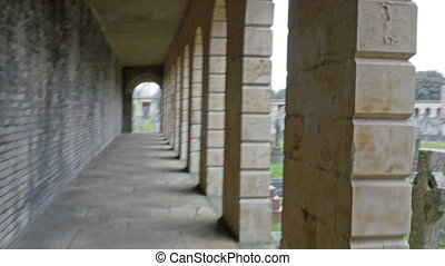 The hallway on a building inside the cemetery Seen are the...