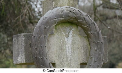 A cross with circle tombstone inside the cemetery Seen on...