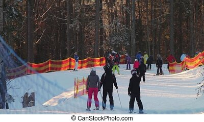 Skiers go on the ski run