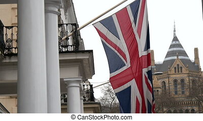 An England flag displayed outside the window