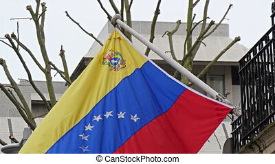 A Venezuelan flag waving on the pole in the terrace of a...
