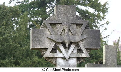 An image of a dove inside an inverted triangle tombstone...