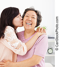 happy daughter kissing her mother