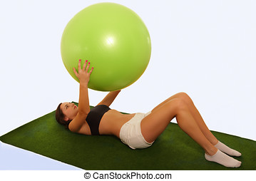 Gym ball exercise, young woman practicing on mat