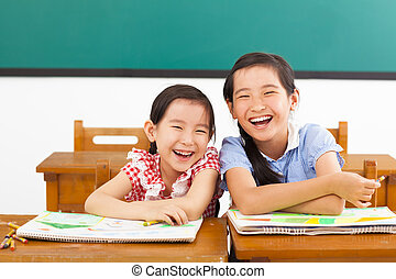 happy little girls in the classroom