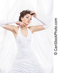 Young, beautiful and emotional bride over white background