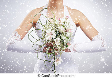 Beautiful wedding bouquet in brides hands Winter background...