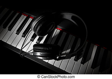 Piano keyboard with headphones