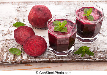 beet Juices and vegetables on white wooden table top view