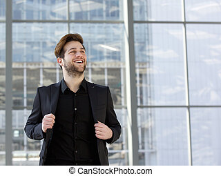 Trendy young man in black business suit